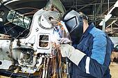 repairman welding metal body car