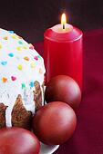 Easter cakes and burning candle