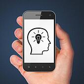 Information concept: Head Whis Lightbulb on smartphone