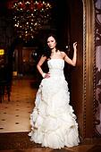 Happy beautiful sexy bride brunette girl woman in white wedding dress with hairstyle and bright makeup in interior