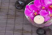 orchids with candle and massage stones