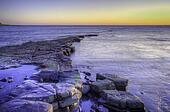 Landscape seascape vibrant Winter sunset long exposure