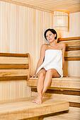 Half-naked lady relaxing in sauna