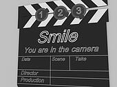 Movie production clapper board notifying to the people that smile you are in the camera