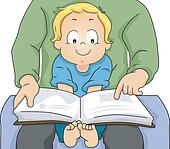 Toddler Boy Reading a Book with his Father