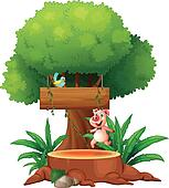 A pig and a bird under the big tree