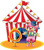 A female clown juggling in front of the tent