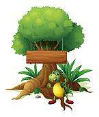 A turtle under the big tree with a wooden signboard