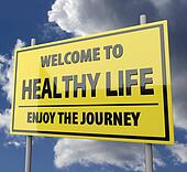 Road sign with words Welcome to healthy life on blue sky background