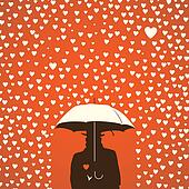 Men under umbrella on hearts shapes rainy