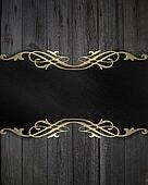 Black frame with a gold pattern on a wooden background