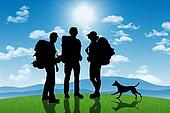 silhouettes of three backpackers, men and a woman, with a dog standing on a top of the hill on mountains landscape background