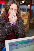 Woman With A Runny Nose In Pharmacy