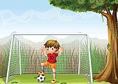A young football player near the big tree