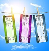 boarding pass tickets  hanging on clothesline over blue sky