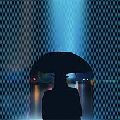 Silhouette of the man under umbrella