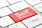 Safety concept: Self Defense on computer keyboard background