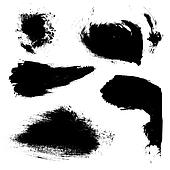 Abstract brush strokes of black paint on white paper