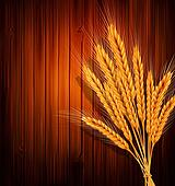 golden ears of wheat on the wooden background