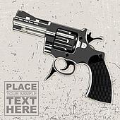 revolver on grunge background
