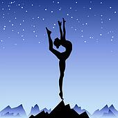 Beautiful flexible girl gymnast staying on one leg.