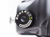 Masterpiece. Close-up of photo camera switch mode .