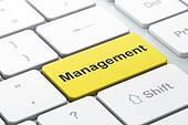 Business concept: Management on computer keyboard background