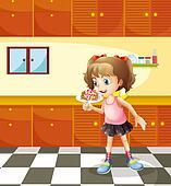 A girl eating lollipop