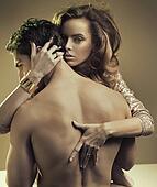 Pretty lady hugging her half-naked boyfriend