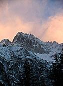 Snowy mountain at sunset