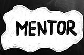 """Mentor"" handwritten with white chalk on a blackboard"