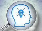 Business concept:  Head With Lightbulb with optical glass on dig