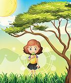 A small girl near the big tree
