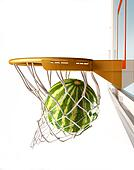 Watermelon centering the basket, close up view.