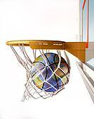 Basket ball with earth globe texture, centering the basket, close up view. On white background (image sources were offered by NASA. These images were improved and enhanced to achieve these maps)