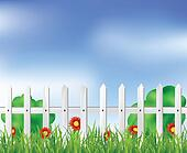 White fence with grass and flowers