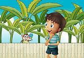 A boy and a monkey near the banana plantation
