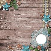 Old wooden background with a frame for photo, flowers, pearls an