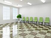 Green chairs in a lobby