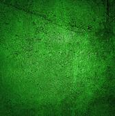 Grunge green paint wall background or texture