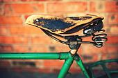 Vintage leather bike saddle with metal spring