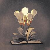drawing idea pencil and light bulb concept outside the book