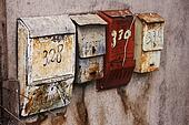 Russian mailboxes on the stucco wall