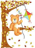 Teddy bear sitting on the tree with