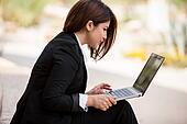 Businesswoman telecommuting