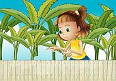 A young girl at the banana plantation
