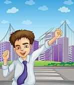 A happy businessman near the pedestrian lane