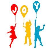 Children holding balloons with Joy message