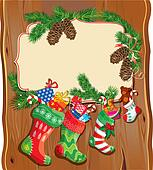 X-mas and New Year card with family Christmas stockings on wood