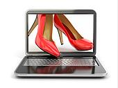 E-commerce. High heel shoes on laptop.